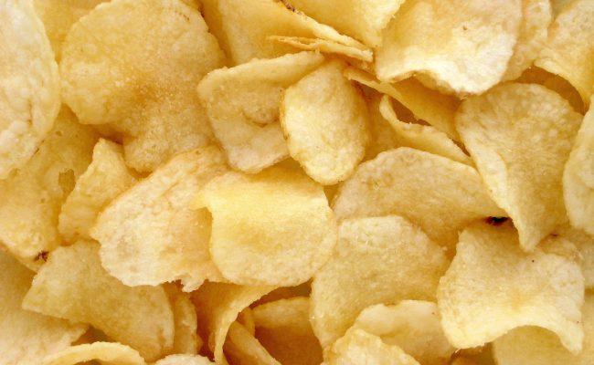 Upclose pile of potato chips / crisps.