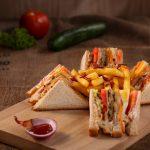A club sandwich on a wooden board