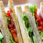 Sandwich with meat, lettuce, tomato - representing the style of food at Panera. Not an image actually from Panera.
